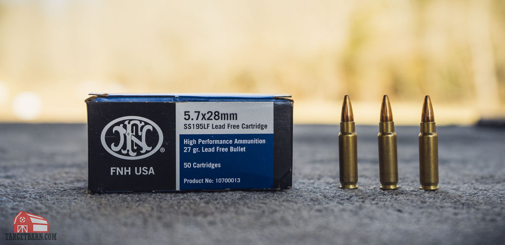 a box and three rounds of FNH 5.7x28mm ammo