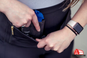 the kydex holster is placed into the Dene Adams Classic Concealed Carry Tactical Leggings pouch and held with velcro