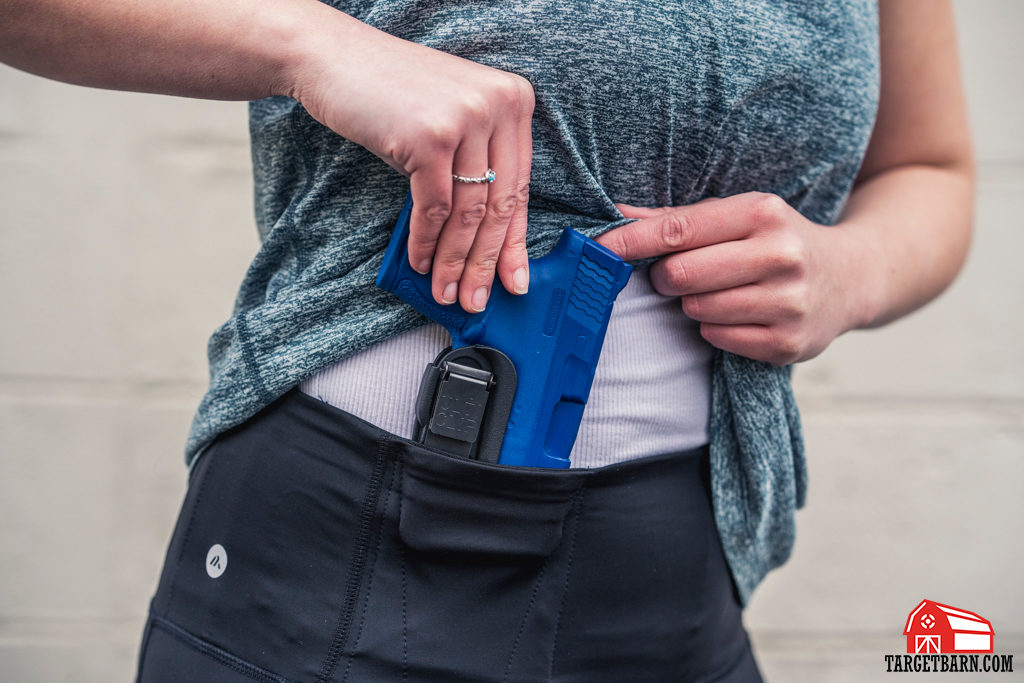Alexo Athletica The Signature Pant concealed carry leggings paired with a holster for added trigger protection