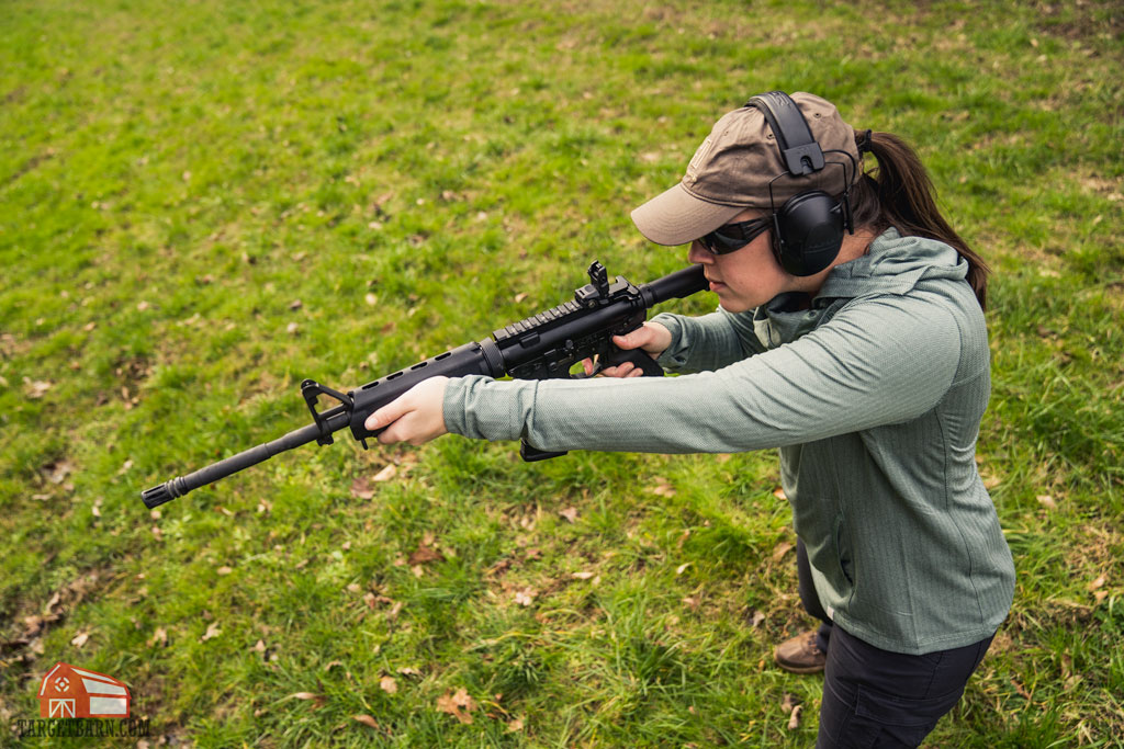 girl shooting an ar-15 on a range