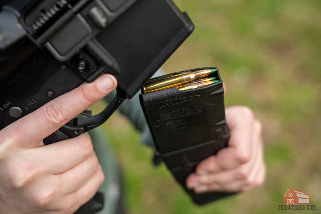 an ar-15 magazine loaded with green tip m855 ammo