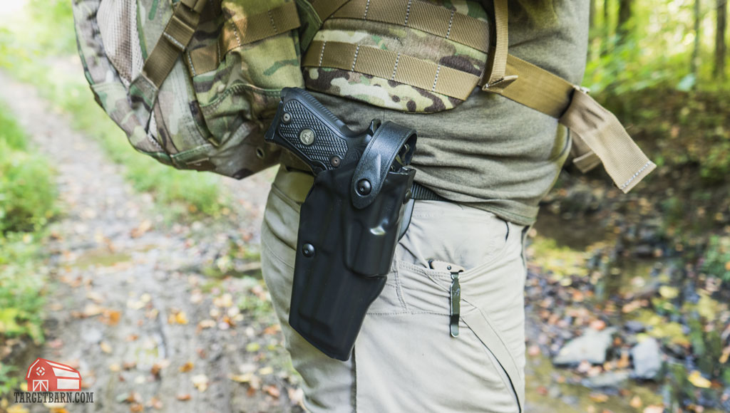 a safariland als retention holster like this one is a good option for backpacking
