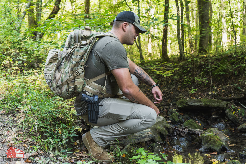 stopping by a stream while backpacking with a gun in a safariland holster