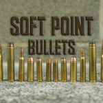 different calibers of soft point bullets displayed at a shooting range