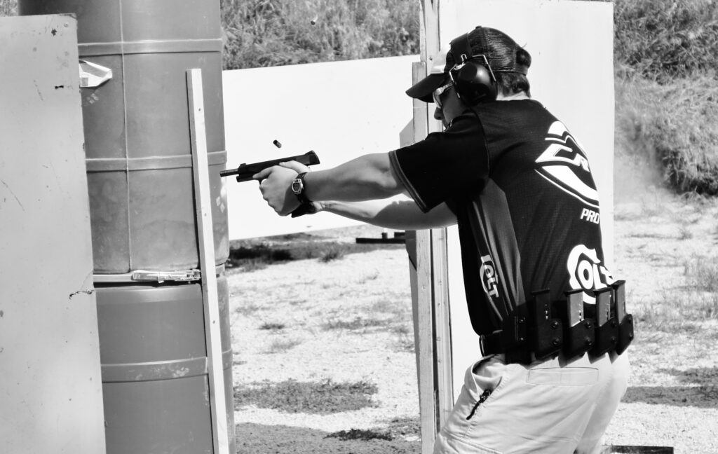 The author using a USPSA scoring strategy during a match