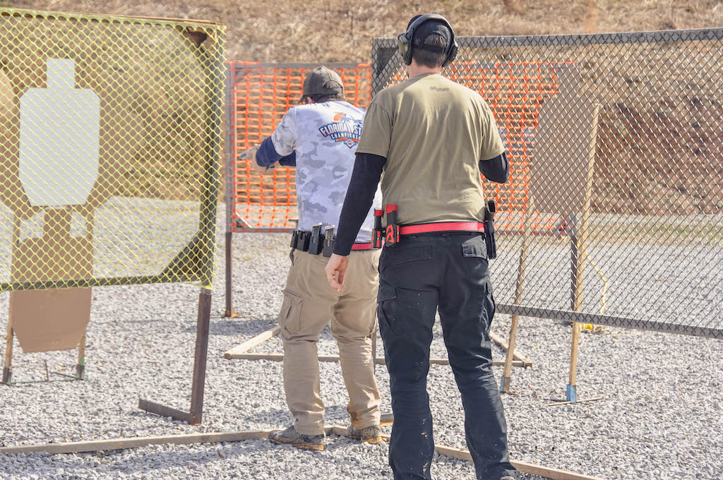 a USPSA shooter shooting a USPSA target in competition