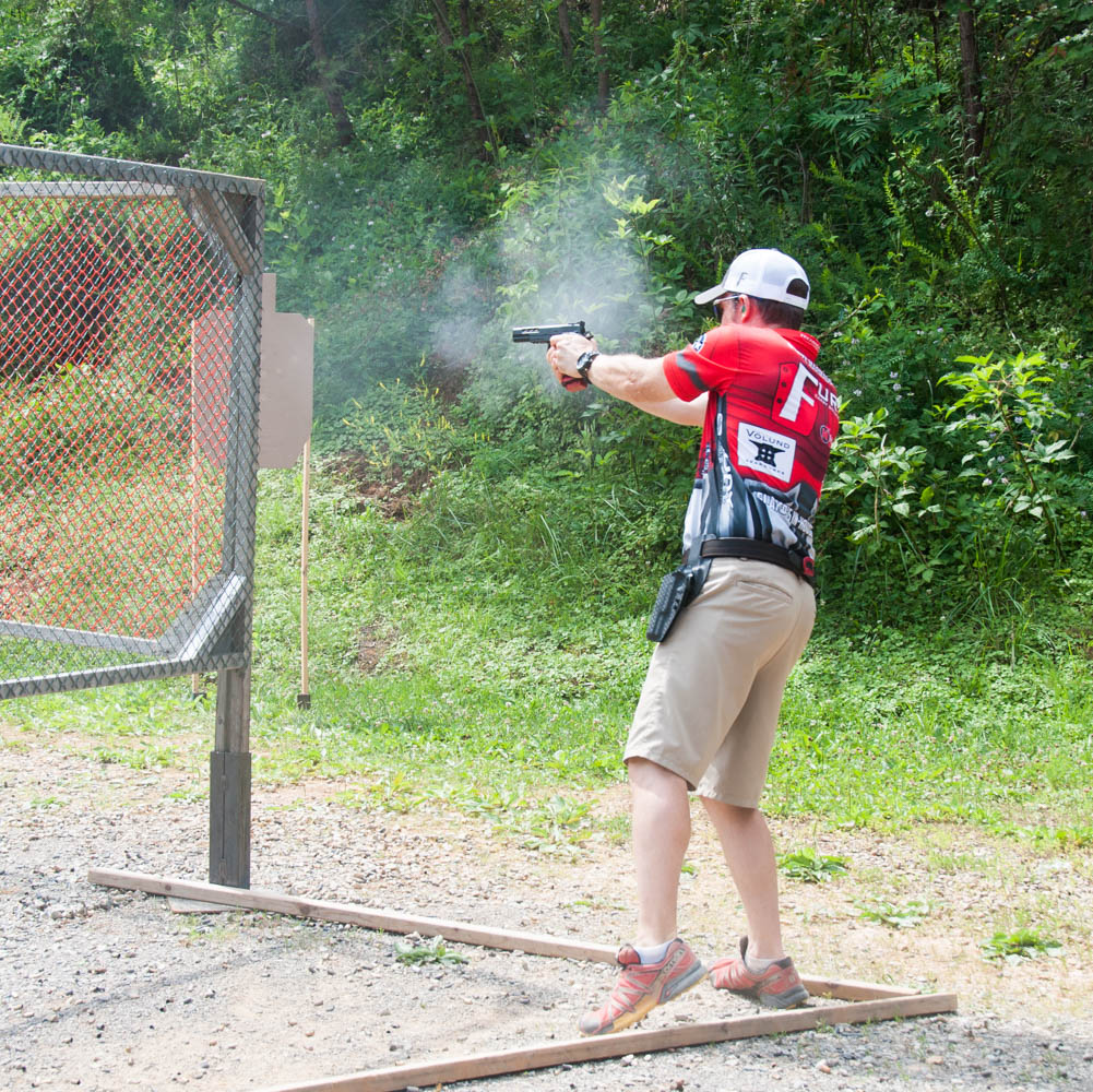 shooter in uspsa limited division shooting a stage