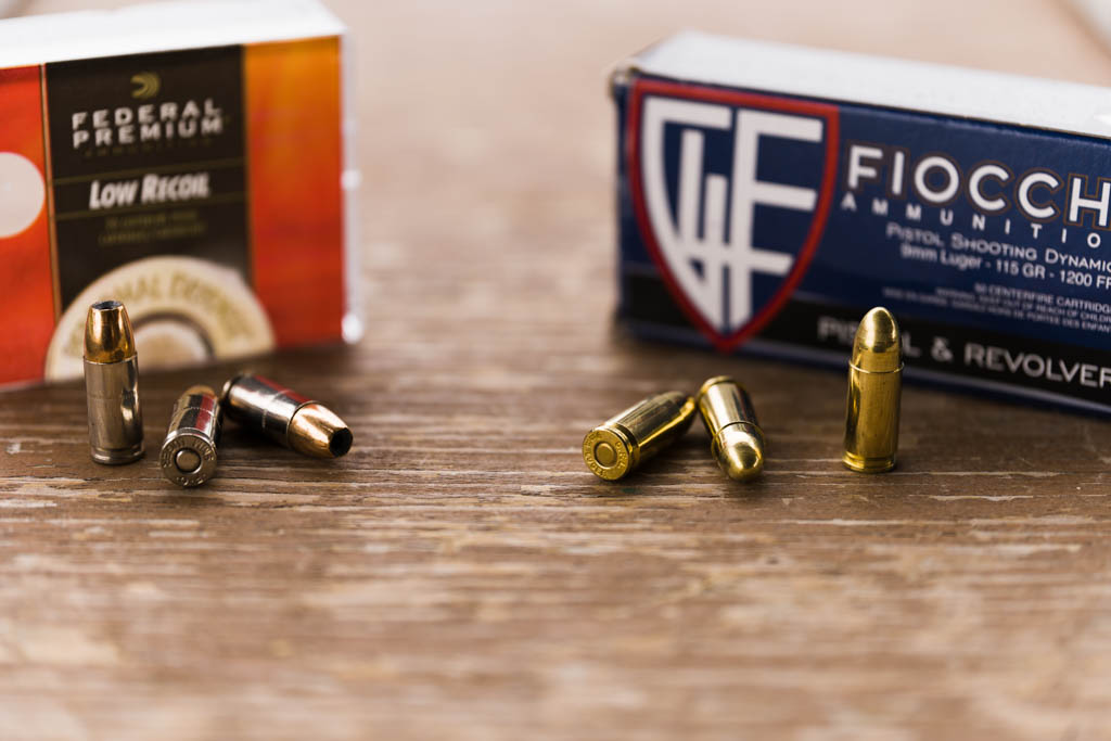 Federal Premium JHP box and rounds next to Fiocchi FMJ box and rounds