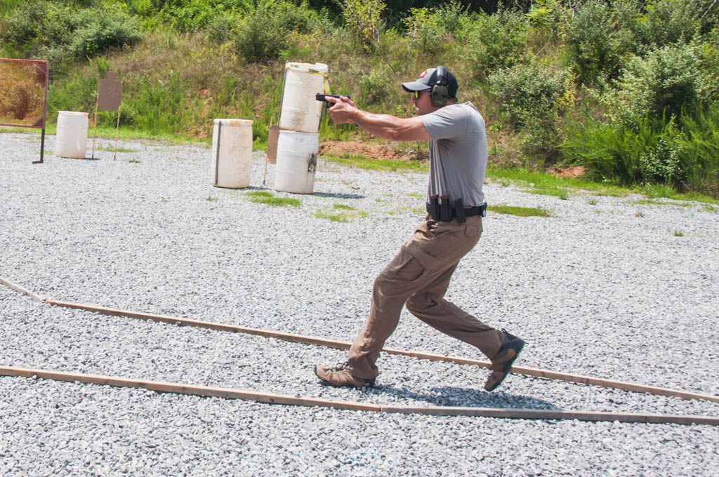 shooter in uspsa production division shooting a stage