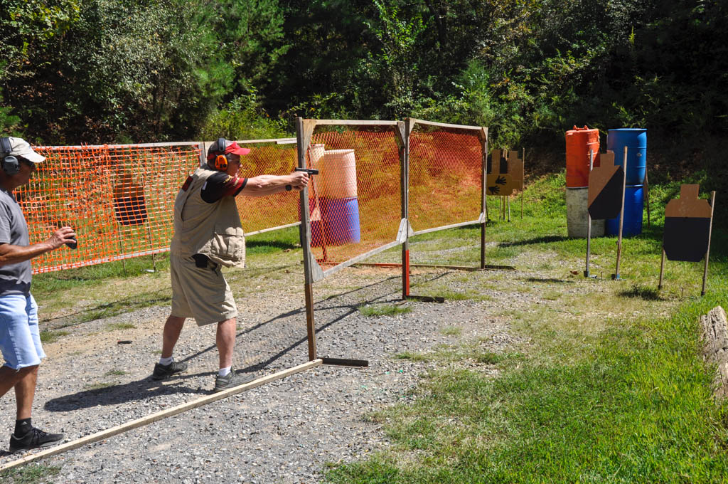 an idpa shooter running through a stage
