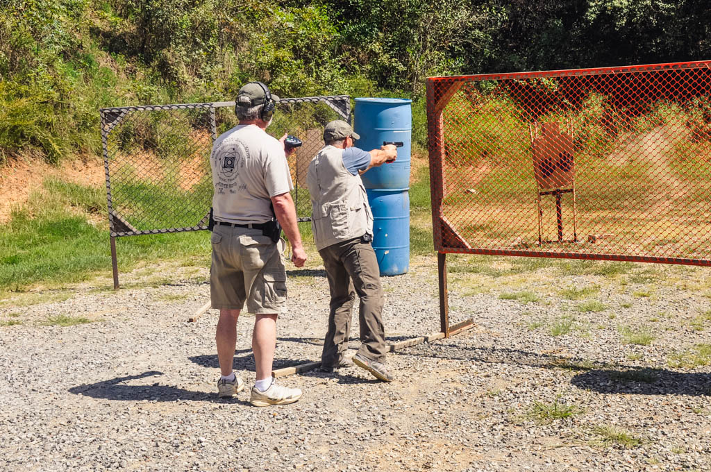 idpa shooter shooting a course of fire