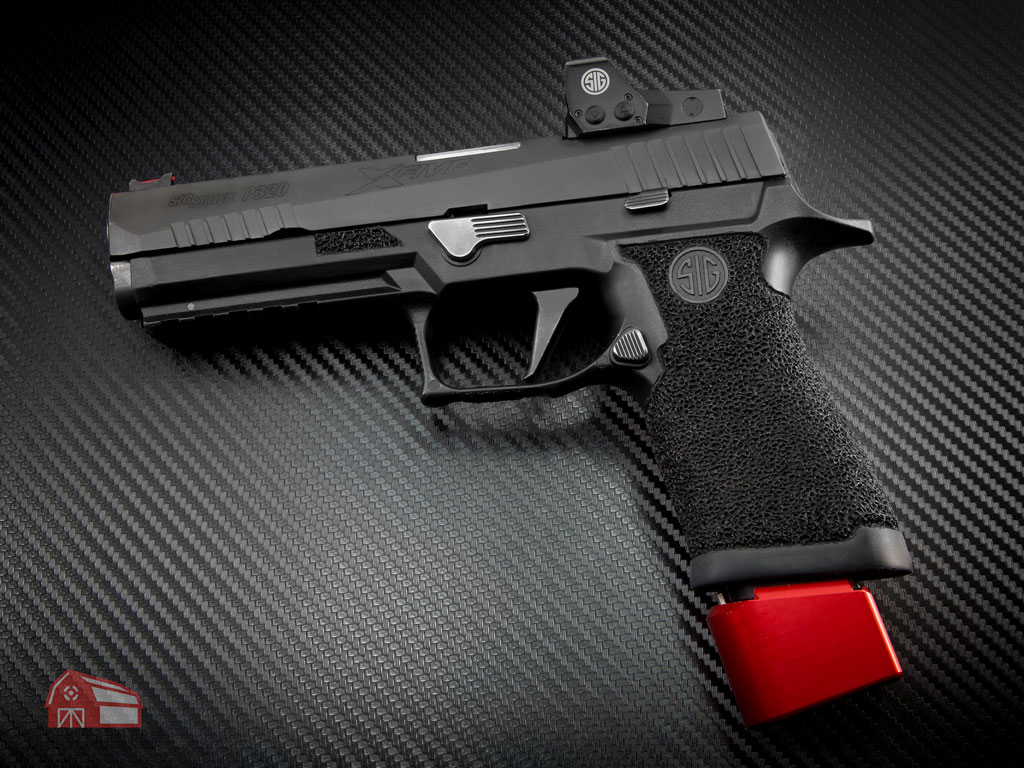 a sig sauer pistol with a sig sauer red dot optic mounted for carry optics division