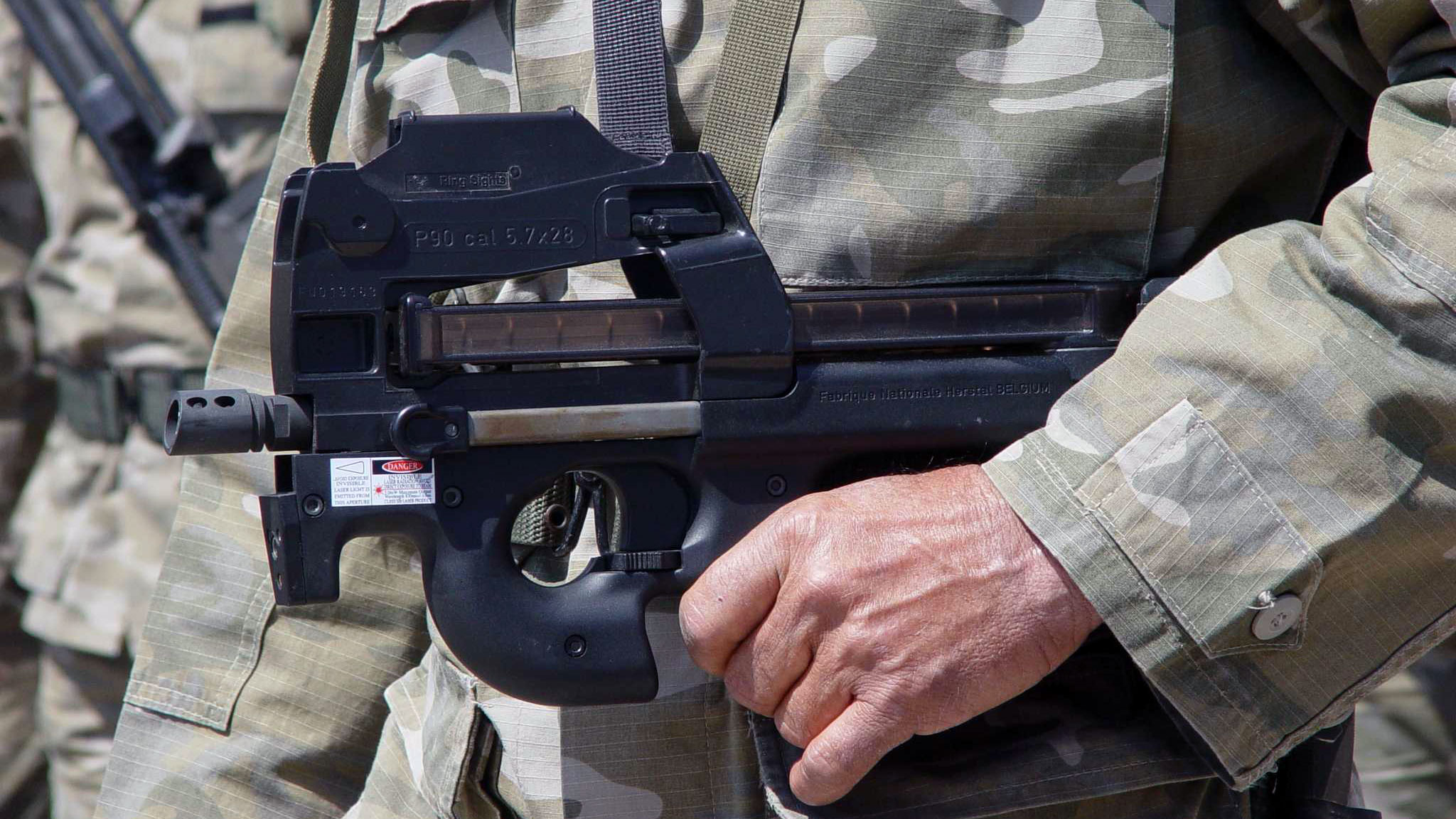 the fn p90 being carried by a member of the cypriot national guard