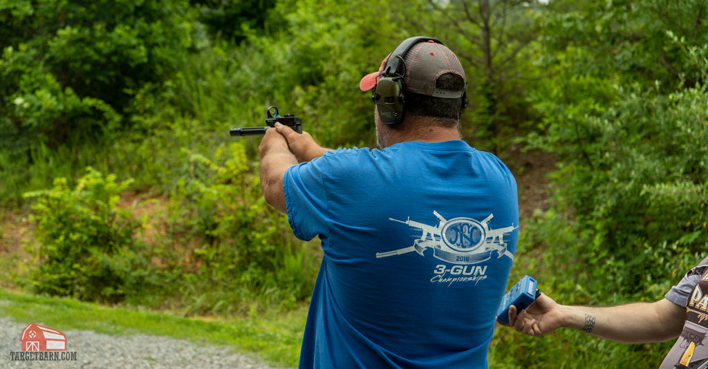 a competitor shooting in the rimfire pistol open steel challenge division
