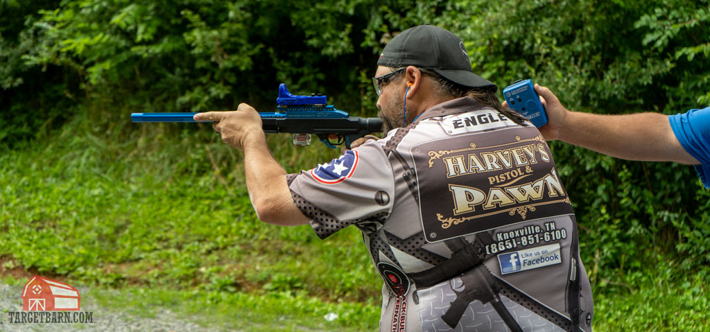 a competitor shooting in rimfire rifle open steel challenge division