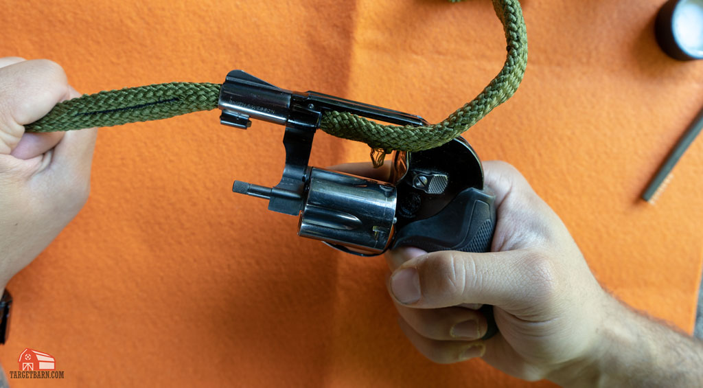 running a boresnake through the revolver's barrel with cleaner
