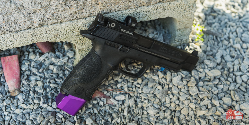 a smith and wesson with vortex red dot and magazine extender for carry optics steel challenge division