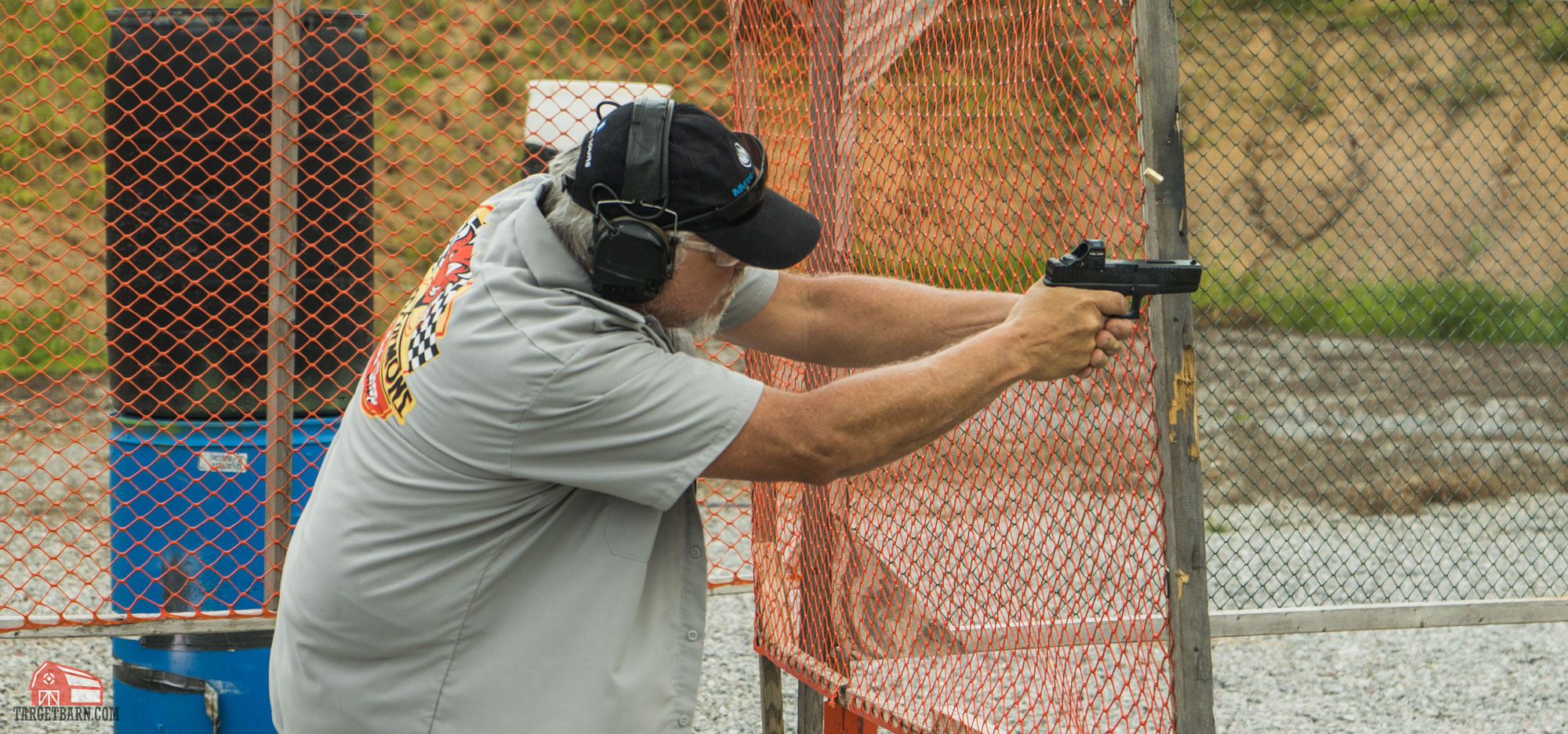 an idpa shooter shooting in carry optics division