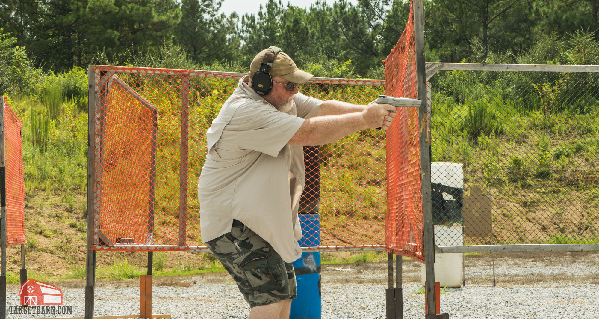 an idpa shooter shooting in the enhanced service pistol division