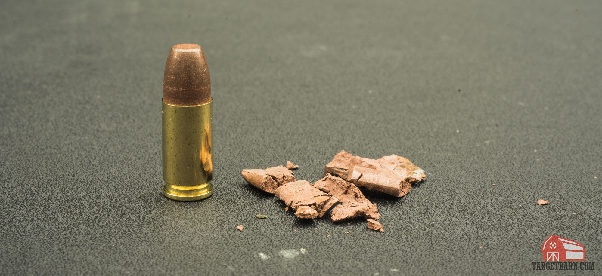 a frangible round next to a shattered frangible bullet