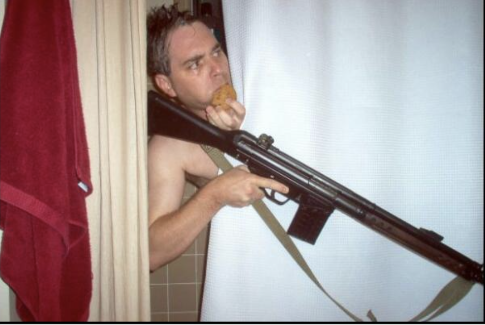 a meme template of a man eating a cookie with an hk93 while in the shower