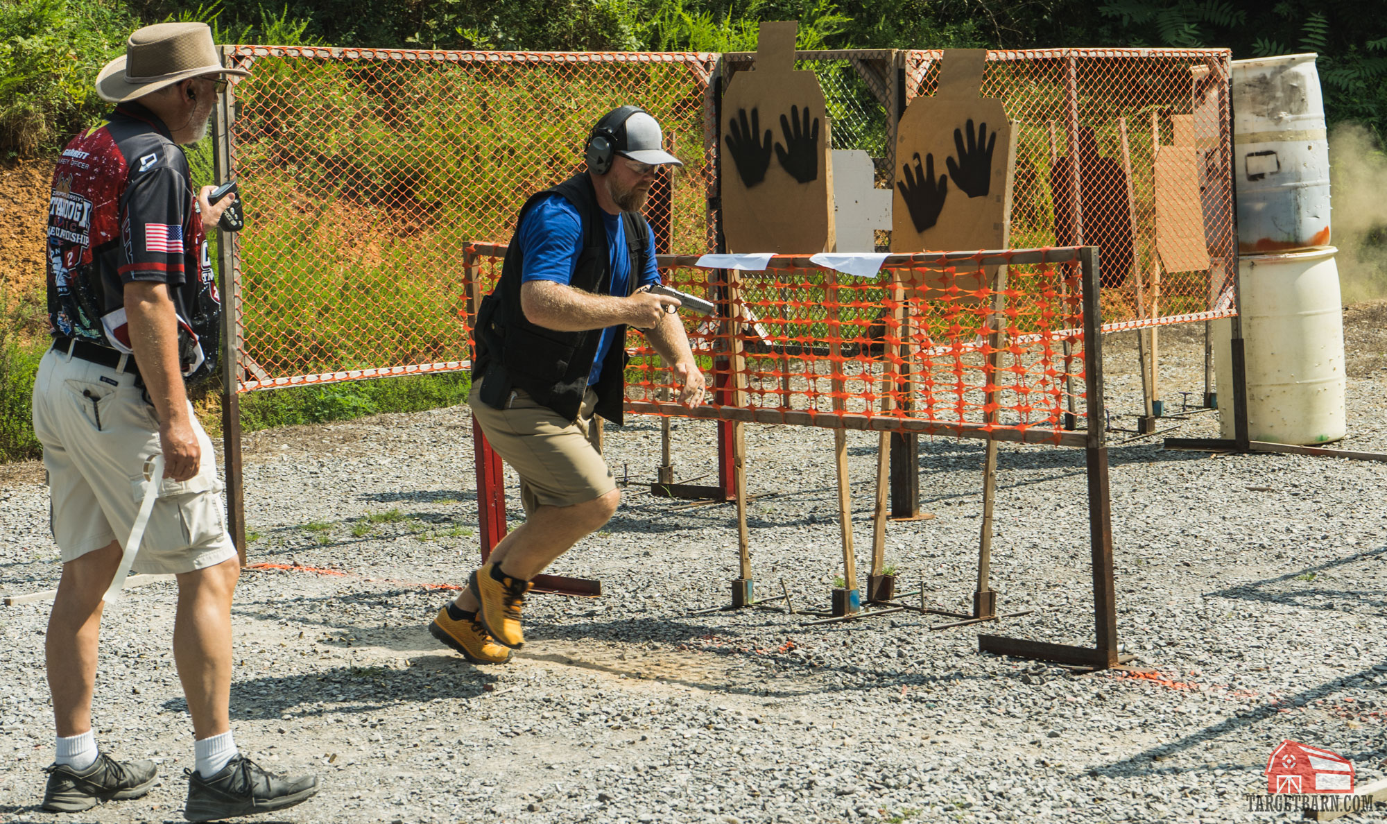 an idpa shooter shooting a stage