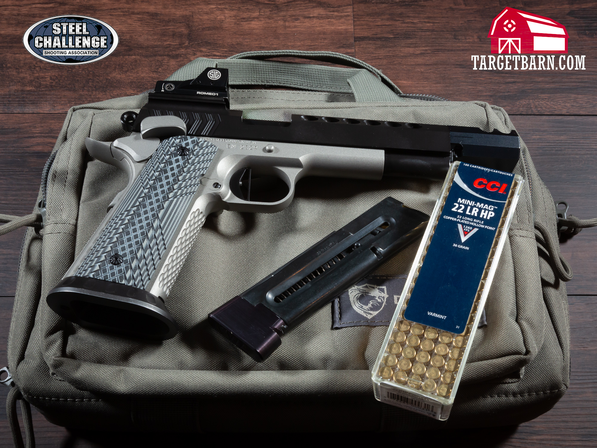 a rimfire pistol, magazine, and ammo for steel challenge