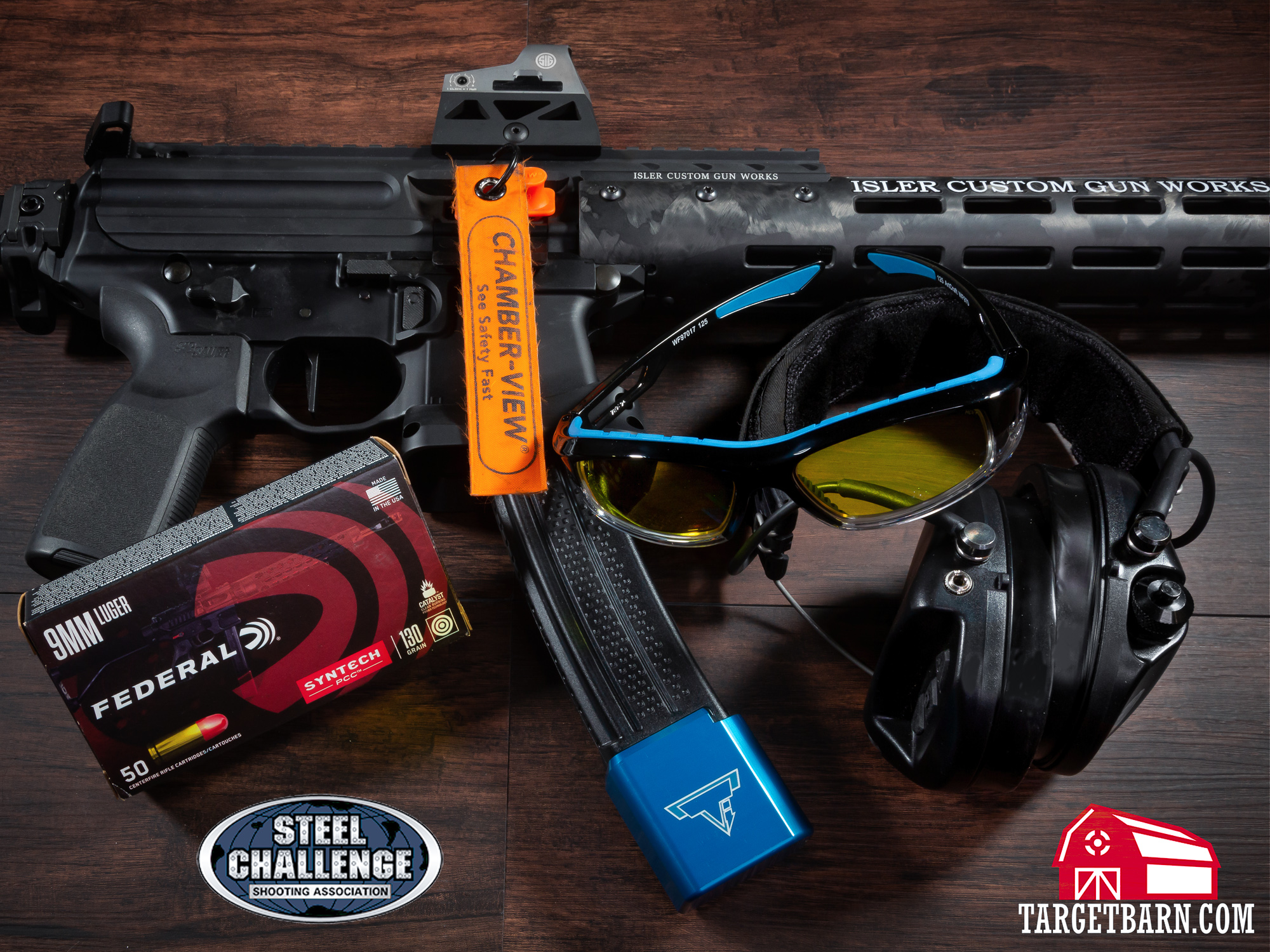 a pcc, eye protection, ear protection, chamber flag, and federal ammo