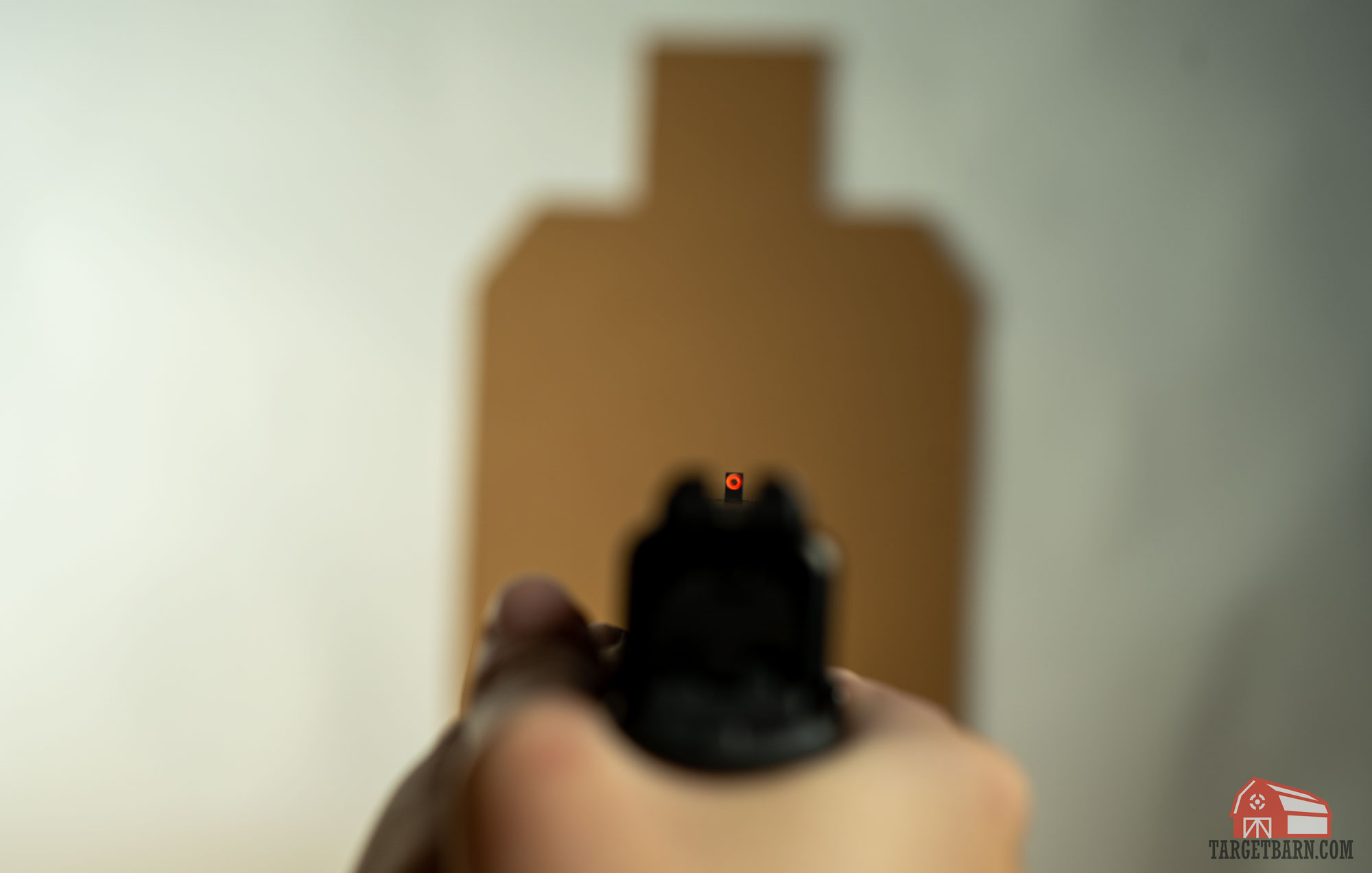 the optimal sight picture has a clear focus on the front sight with a blurry target