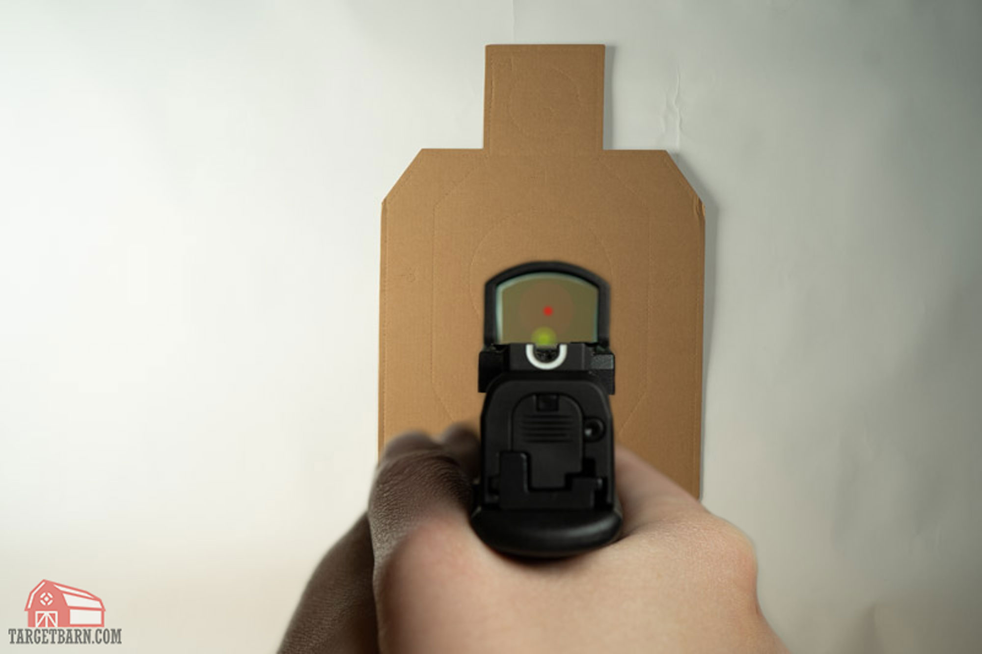 with red dot sights, put the dot on the target with a focus on the target
