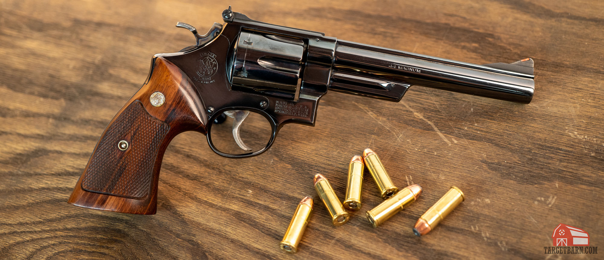 a smith and wesson model 29 revolver with 44 magnum ammo