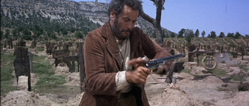 tuco from the good, the bad, and the ugly shooting a single action revolver